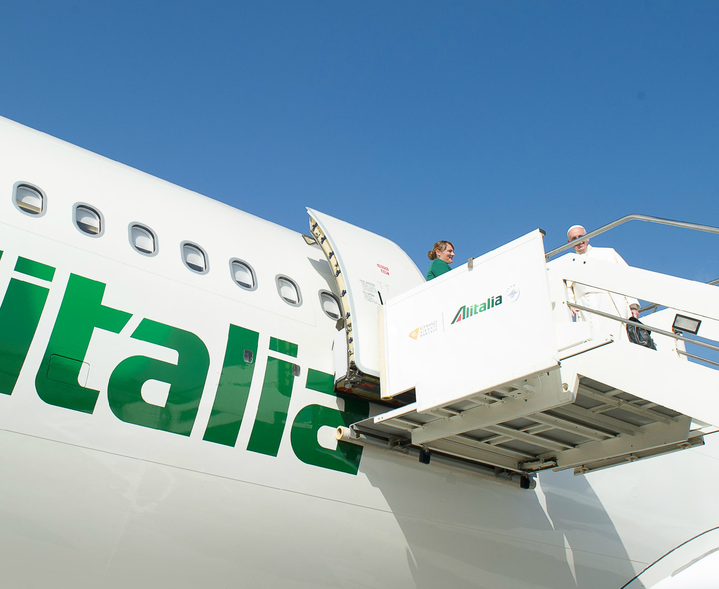 Pope Francis on the Alitalia plane