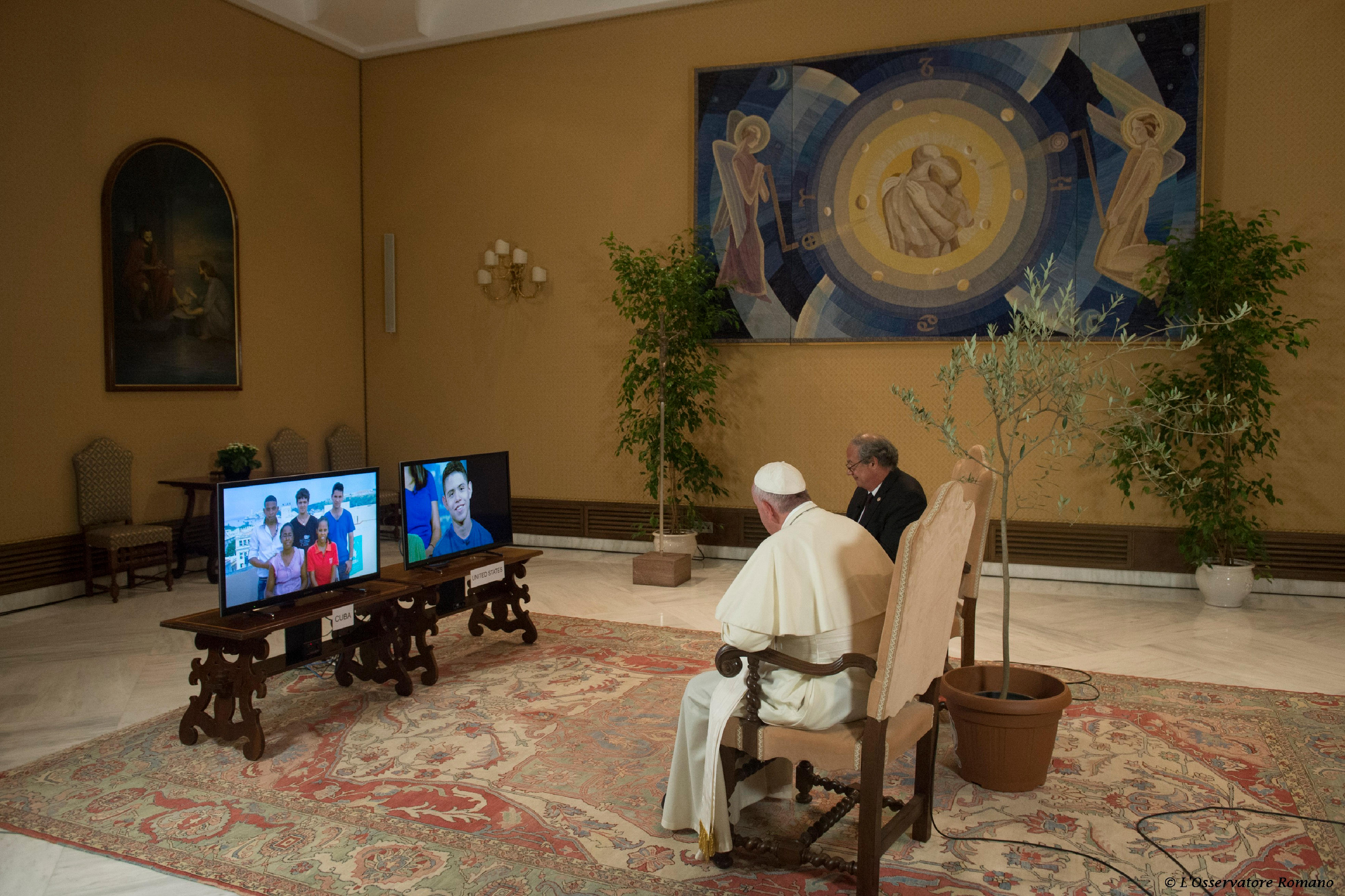 Pope Francis responds from the Vatican to questions from students in Cuba and USA during a CNN teleconference