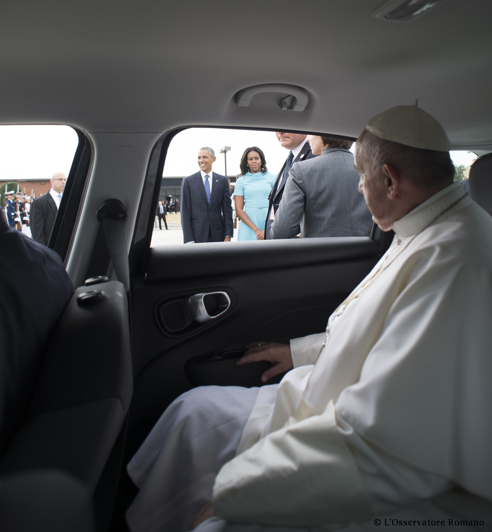Pope Francis' sitting in a Fiat 500 L ready to leave Joint Base Andrews near Washington D.C.