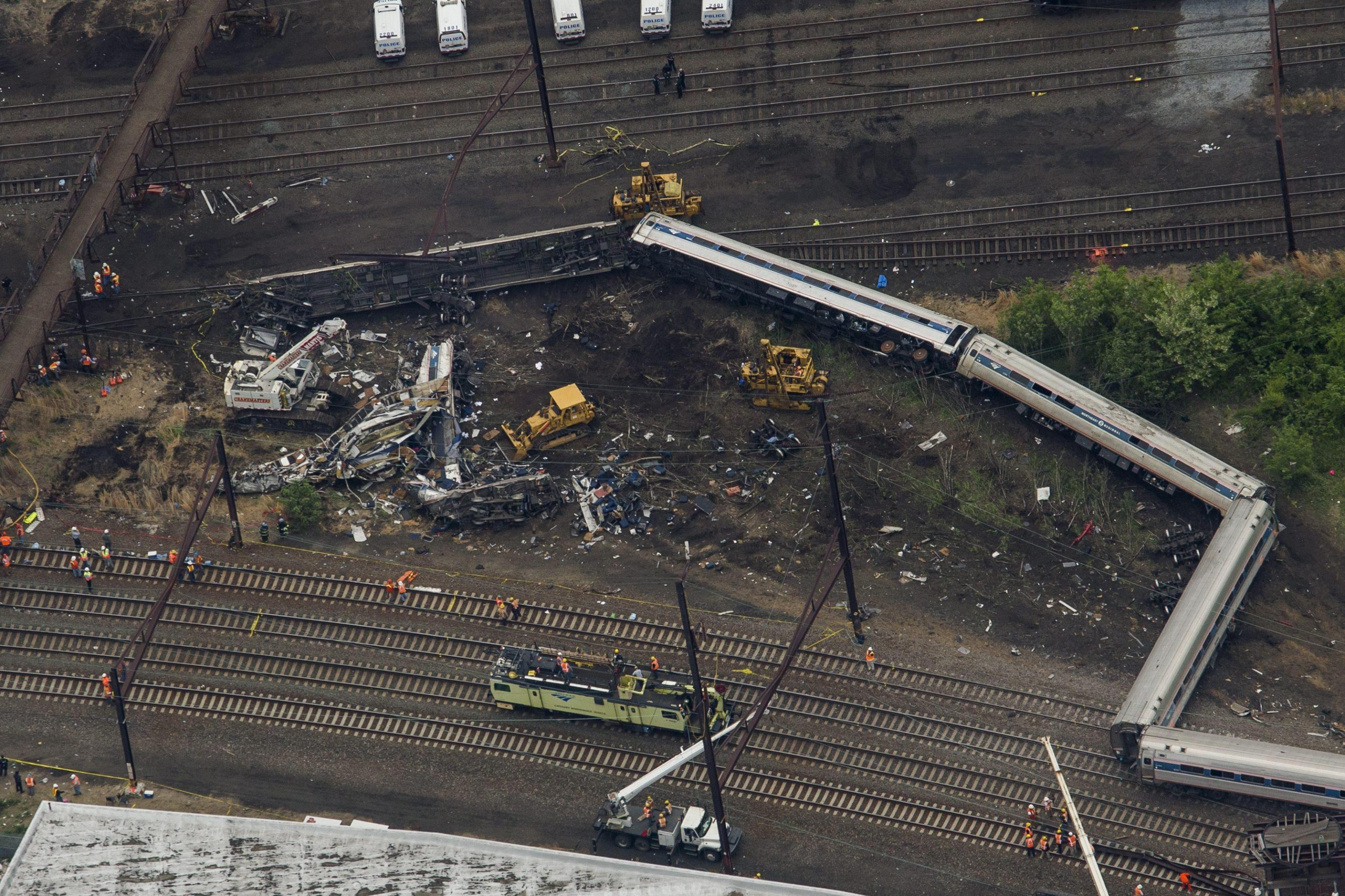 Remains of an Amtrak train that derailed on its way from Washington