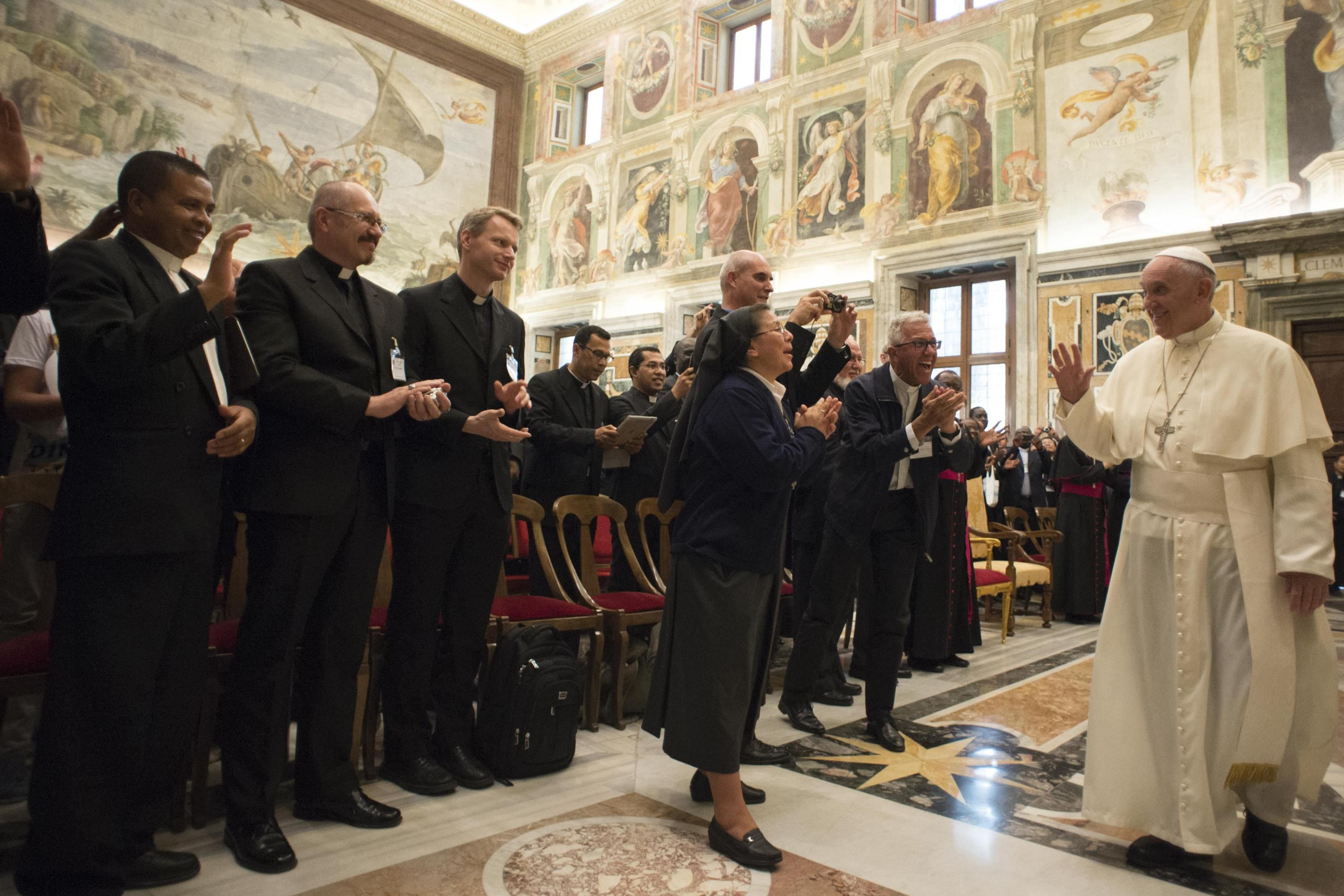 Pope Francis greets participants in the general assembly of Pontifical Mission Societies