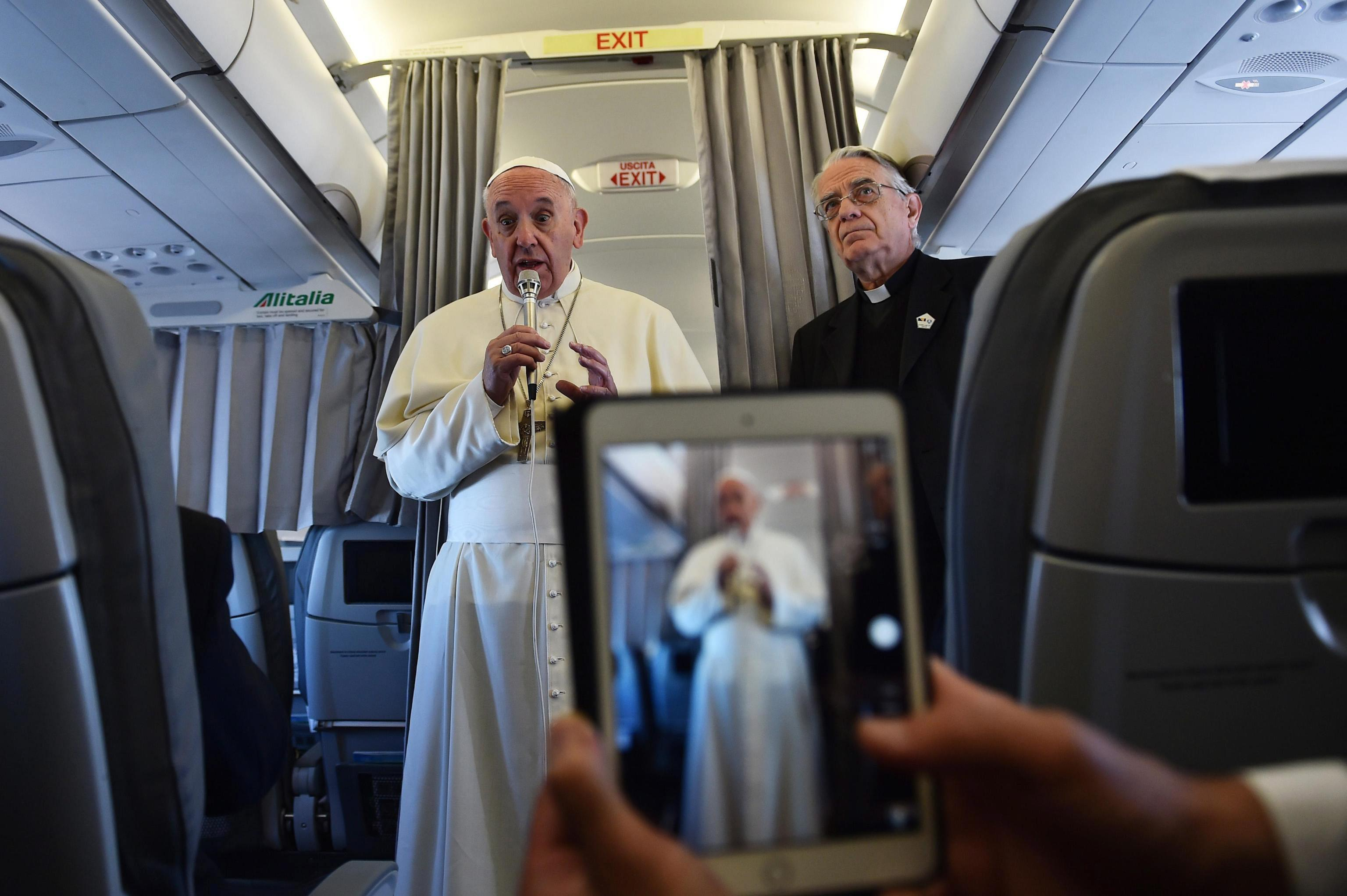 Pope Francis addresses journalists aboard the plane heading to Sarajevo