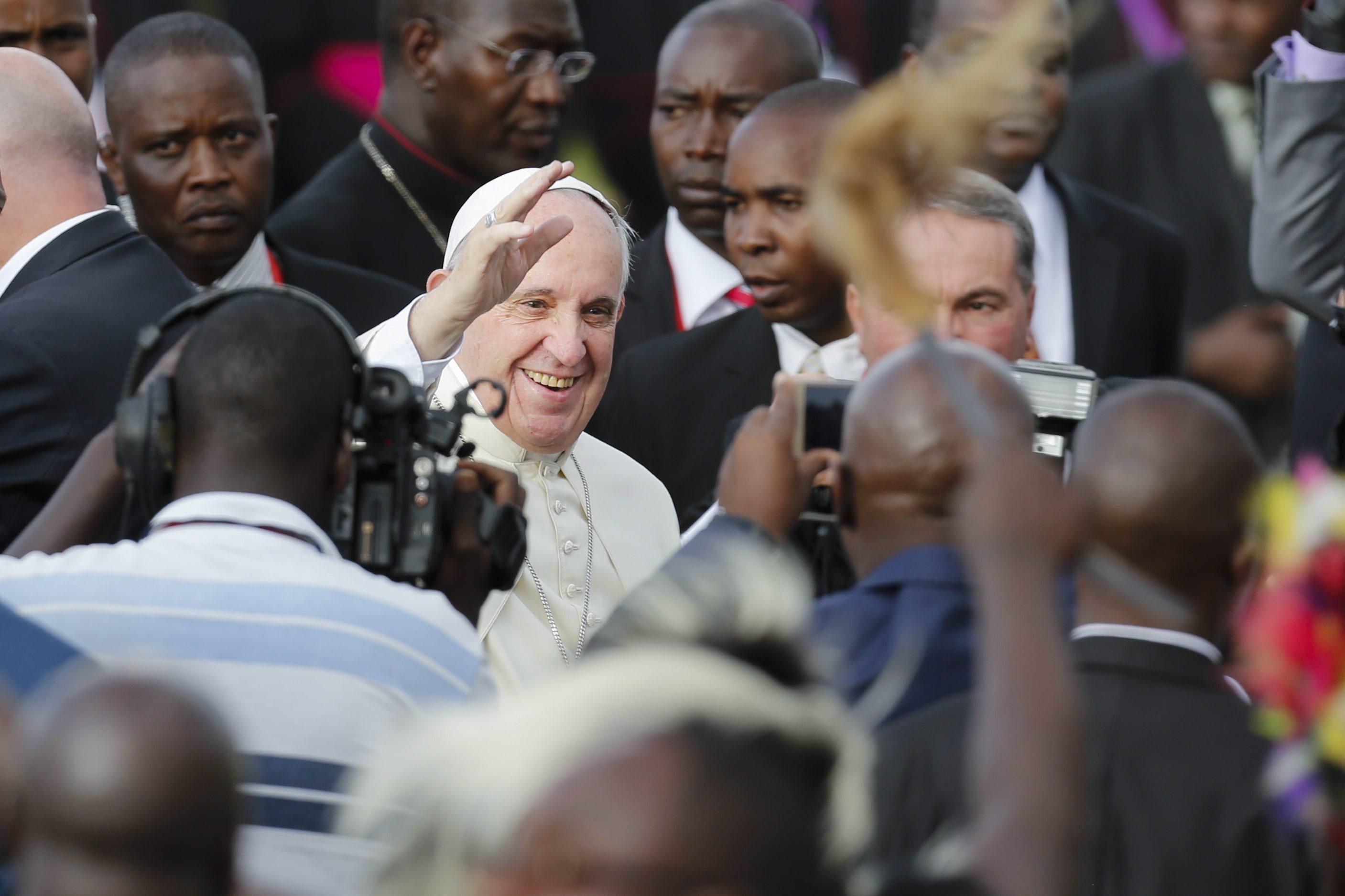 Pope Francis smiles at his arrival at Jomo Kenyatta International Airport in Nairobi