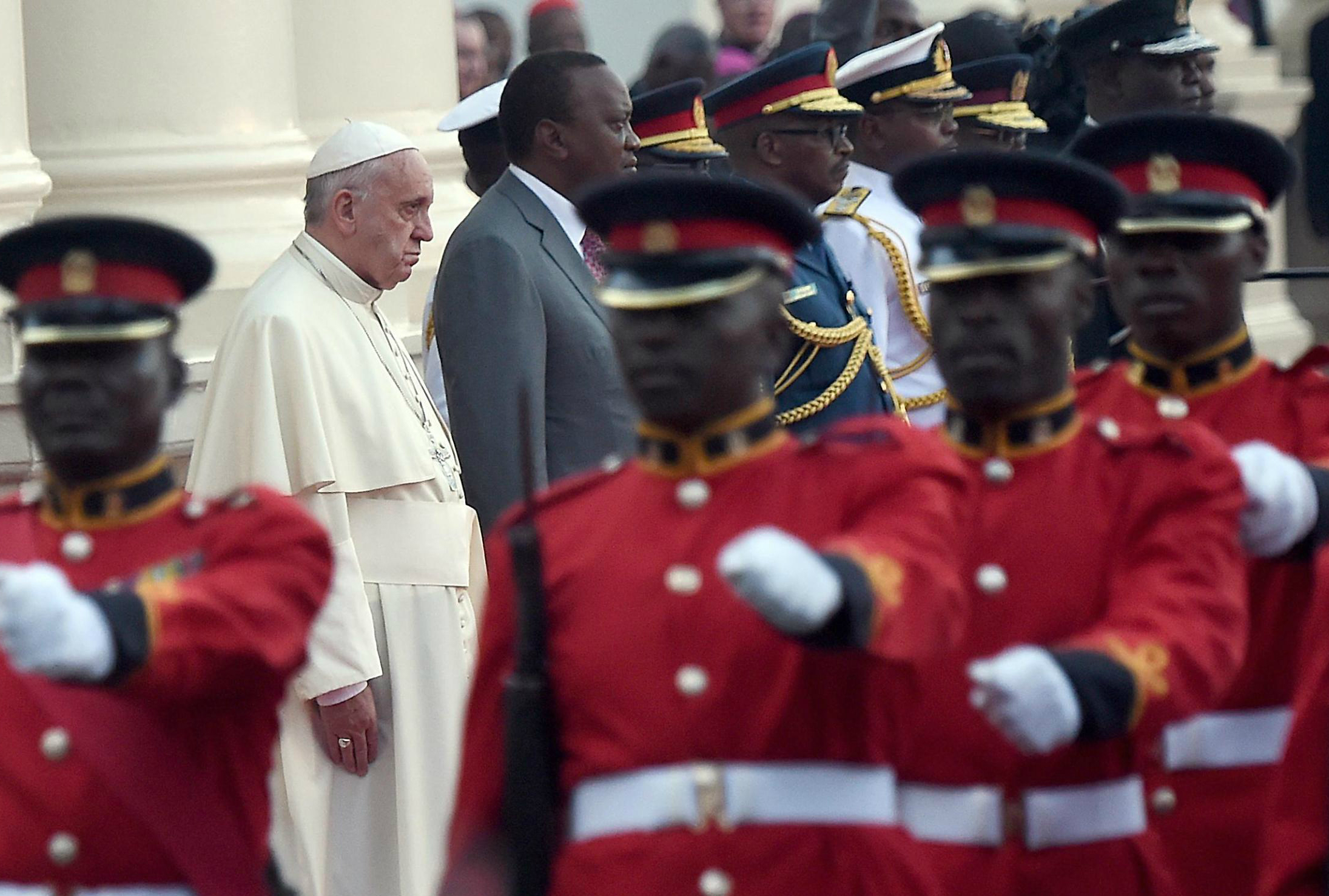 Pope Francis attends a welcome ceremony at the State House in Nairobi with Kenya's president Uhuru Kenyatta (2 L) at the State House in Nairobi