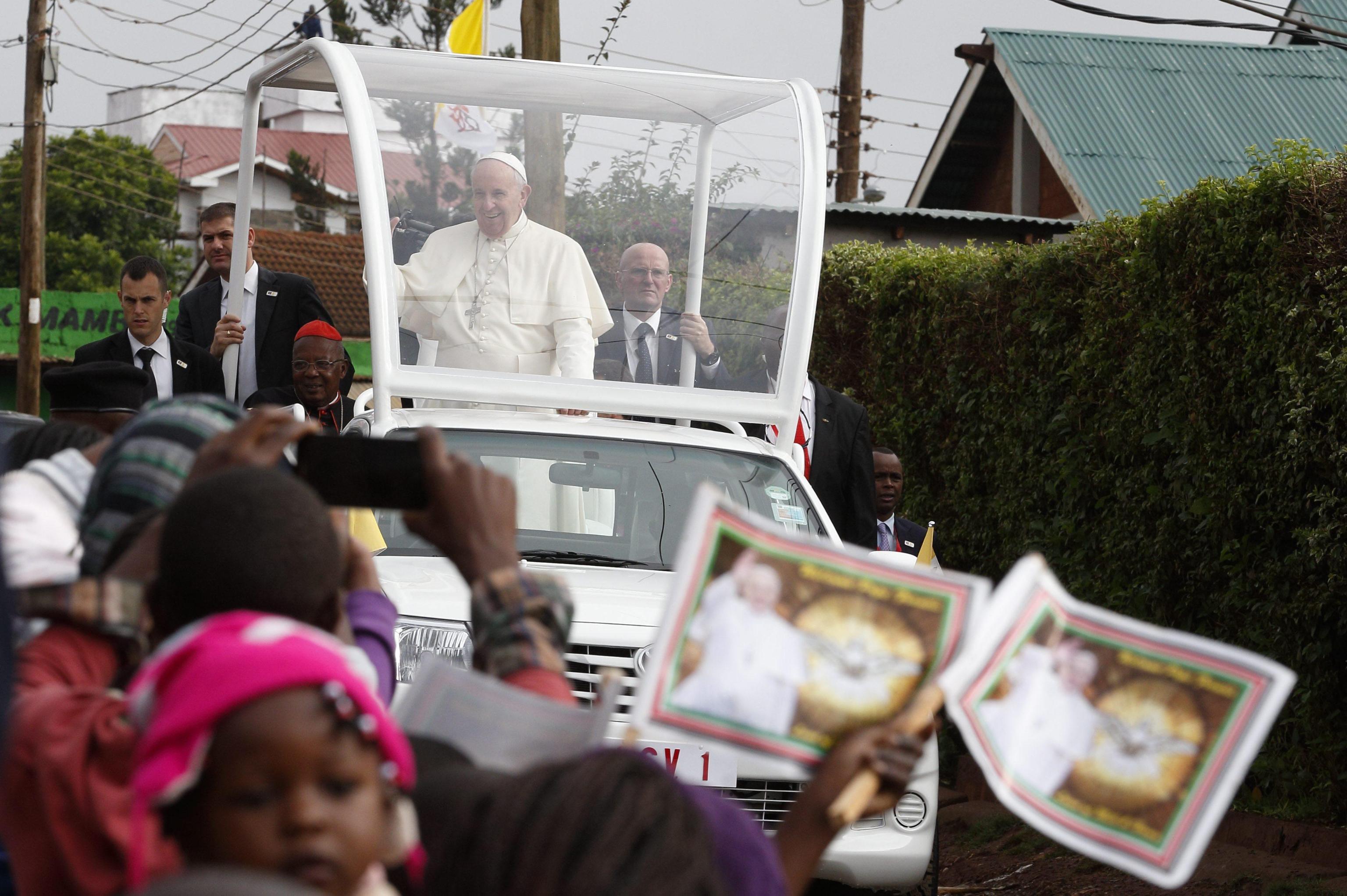Pope Francis arrives to visit a Catholic parish in the Kangemi slum on the outskirts of Nairobi