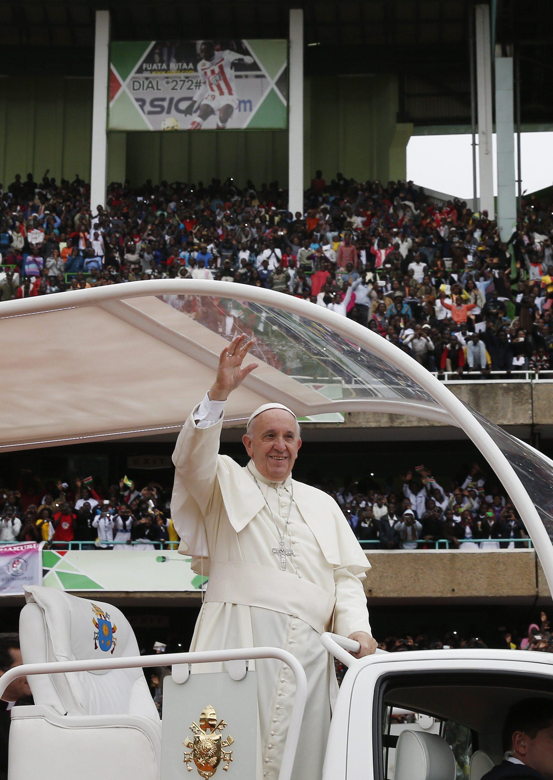 Pope Francis arrives for a meeting with youths at the Kasarani Stadium in Nairobi