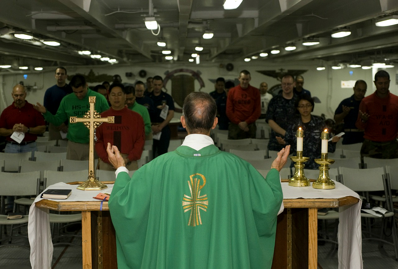 A priest celebrates Holy Mass on board of a warship