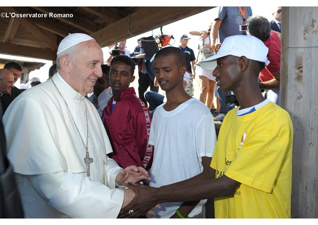 Pope with migrants and refugees
