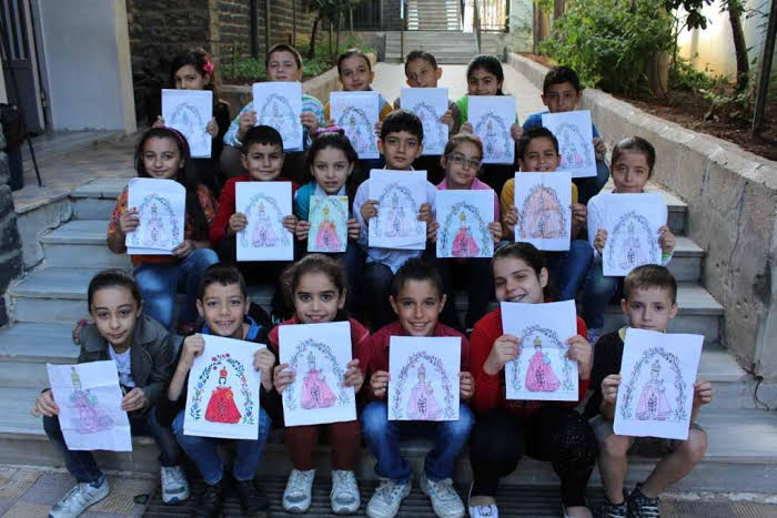 With image of children from Al Nouzha, Homs showing pictures of the Infant of Prague which they drew in Catechism classes (Photo © ACN).