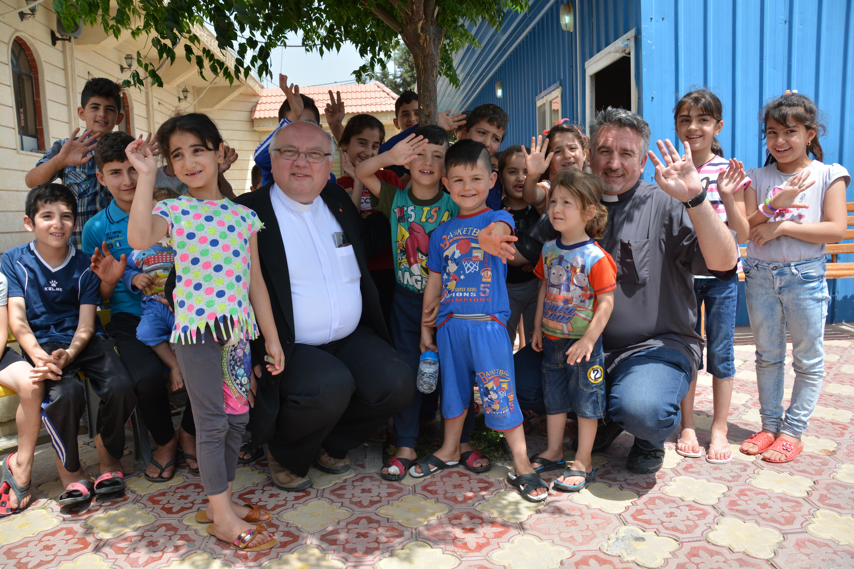 ACN Communications Trip Middle East, 17 – 25 May 2016 Chaldean Catholic Mar Elia Refugee Camp, Fr Douglas Barzi and Fr. Dr. Andrzej Halemba, Erbil, Iraq, ACN Photo