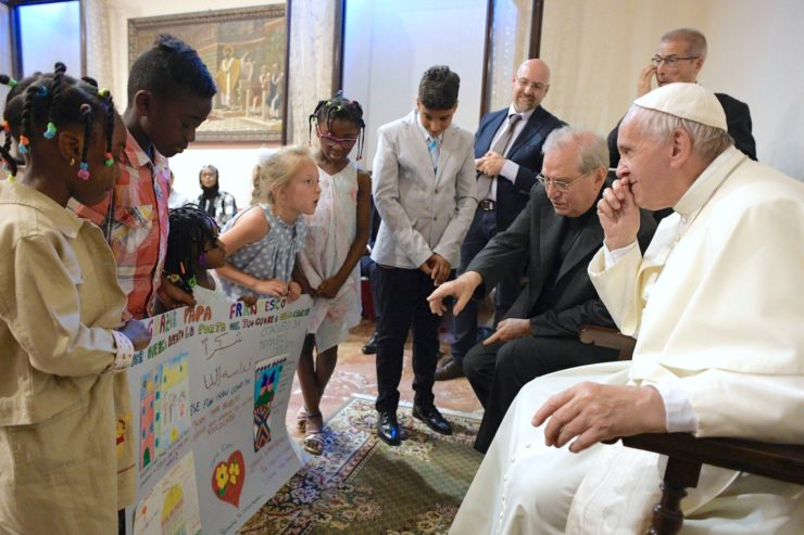 Pope Greets Refugee Families Housed by Roman Parishes